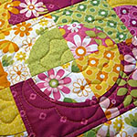 Drunkard's Path quilt using the nested Small Daisy templates to help highlight the circles -Quilt by Patti Anderson